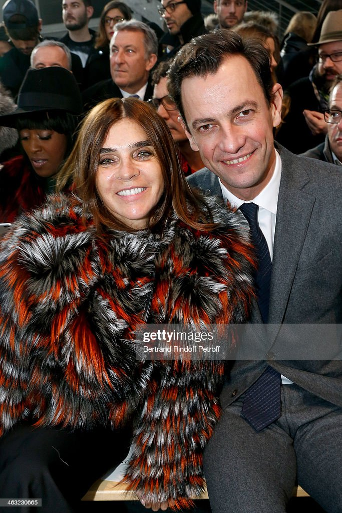 Journalist <a gi-track='captionPersonalityLinkClicked' href=/galleries/search?phrase=Carine+Roitfeld&family=editorial&specificpeople=240177 ng-click='$event.stopPropagation()'>Carine Roitfeld</a> and CEO Division Mode for LVMH Group Pierre-Yves Roussel attend the Givenchy Menswear Fall/Winter 2014-2015 Show as part of Paris Fashion Week. Held at Halle Freyssinet on January 17, 2014 in Paris, France.