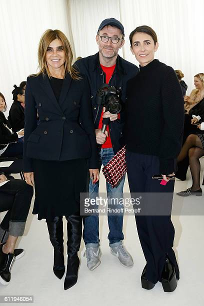 Journalist Carine Roitfeld Photographer Loic Prigent and jouralist Mademoiselle Agnes Boulard attend the Balenciaga show as part of the Paris Fashion...