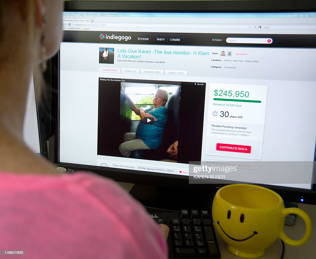 A journalist checks out the fundraising website indiegogo.com on June 21, 2012 in Washington, DC. indiegogo.com started accepting donations, aiming to raise $5,000 USD to send bus monitor Karen Klein on a vacation. By Thursday afternoon, it had collected a whopping $245,000 USD from more than 8,800 people. A 10-minute video of Klein, an elderly school bus monitor in New York state jeered by cussing children provoked outrage and online fundraising will now pay for a vacation. In the video, shot on a cell phone on Monday and posted subsequently on Facebook and YouTube, Karen Klein tries her best to ignore taunts such as 'fat ass' and 'asshole' from kids in the town of Greece, near Rochester. The 12- and 13-year-olds teased the 68-year-old grandmother of eight about her weight, her hearing aid, her hairdo. One leans in and says he will 'piss on your door,' while others make rude gestures and laugh. Klein did not report the harassment but the video -- captured by a kid on the Greece Athena Middle School bus -- was viewed by more than two million people online and led to an outpouring of support for the bullied monitor. AFP PHOTO/Karen BLEIER