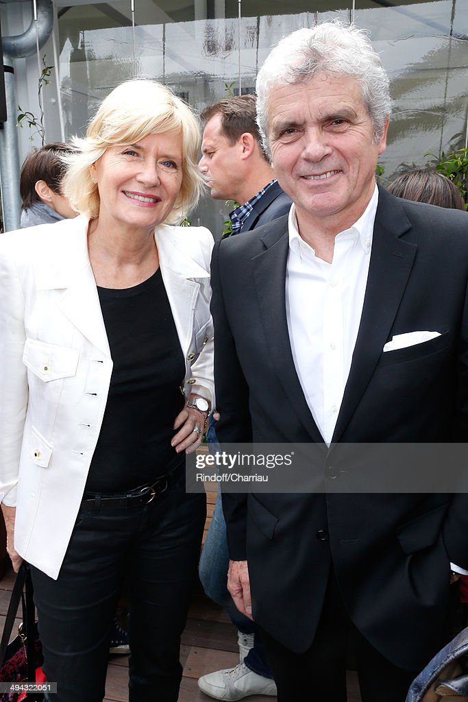 Journalist Claude Serillon and his wife Catherine Ceylac attend the Roland Garros French Tennis Open 2014 - Day 5 on May 29, 2014 in Paris, France.