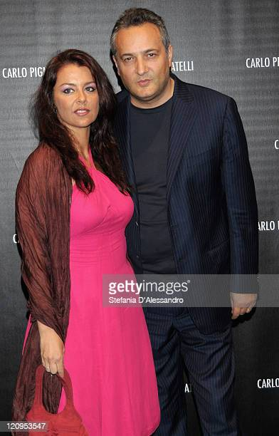 Journalist Claudio Brachino and his wife attend Carlo Pignatelli Cerimonia Fashion Show during Milan Fashion Week Menswear Spring/Summer 2010 on June...