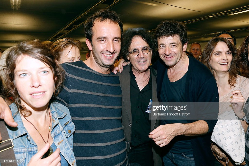 Journalist Cyrille Eldin (2nd L) with his wife (1st L), Eric Assous (C) with his companion (1st R) and Patrick Bruel (2nd R) backstage after Patrick Bruel's last concert in Paris, held at Palais Omnisports de Bercy on June 22, 2013 in Paris, France.