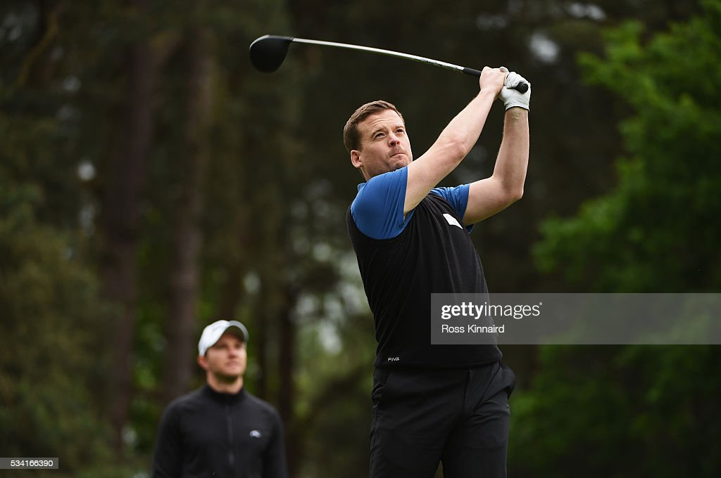 Journalist Dan Jones hits a shot watched by <a gi-track='captionPersonalityLinkClicked' href=/galleries/search?phrase=Maximilian+Kieffer&family=editorial&specificpeople=3333431 ng-click='$event.stopPropagation()'>Maximilian Kieffer</a> of Germany during the Pro-Am prior to the BMW PGA Championship at Wentworth on May 25, 2016 in Virginia Water, England.