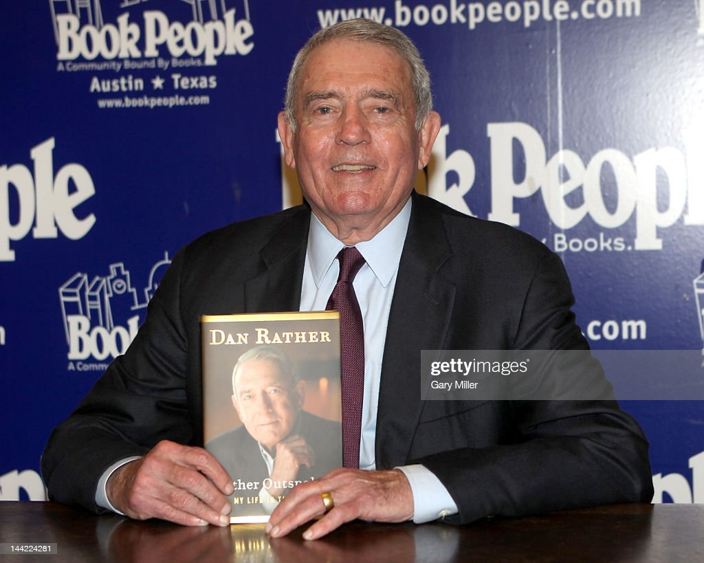 Journalist Dan Rather poses with a copy of his new book 'Rather Outspoken' at Book People on May 11, 2012 in Austin, Texas.