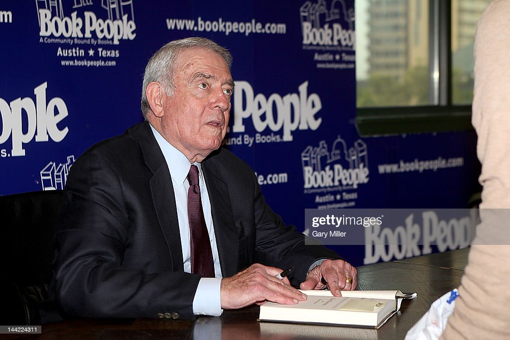 Journalist <a gi-track='captionPersonalityLinkClicked' href=/galleries/search?phrase=Dan+Rather&family=editorial&specificpeople=209204 ng-click='$event.stopPropagation()'>Dan Rather</a> signs copies of his new book 'Rather Outspoken' at Book People on May 11, 2012 in Austin, Texas.