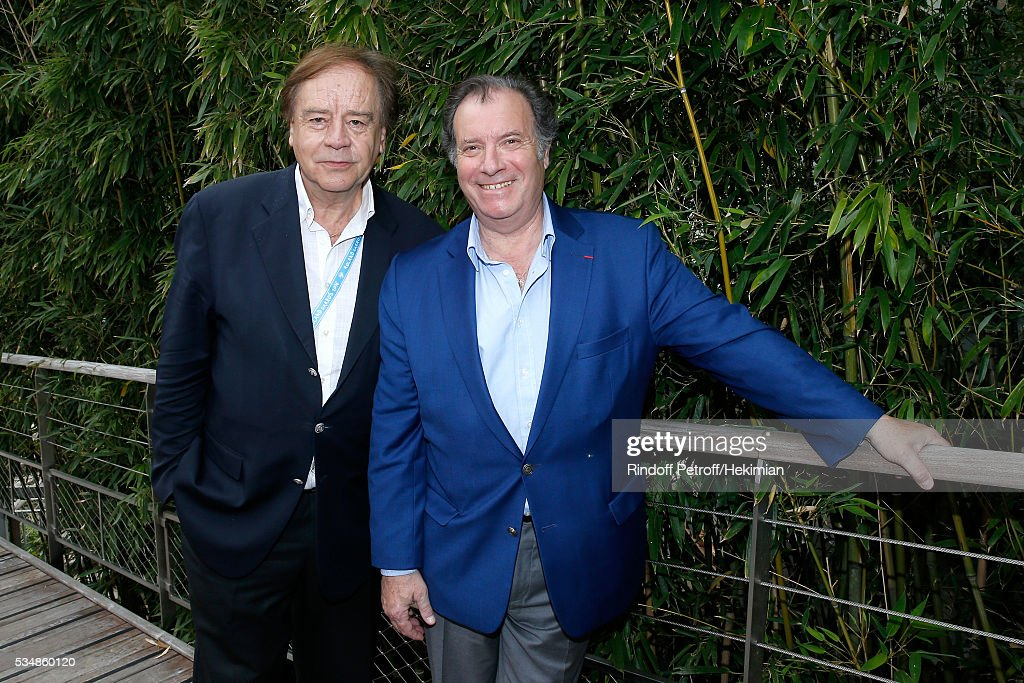 Journalist Daniel Lauclair and actor Daniel Russo attend Day Seven of the 2016 French Tennis Open at Roland Garros on May 28, 2016 in Paris, France.