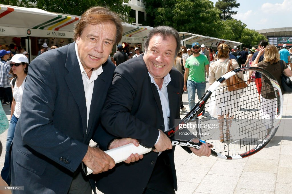 Journalist Daniel Lauclair (L) and actor Daniel Russo sighting at Roland Garros Tennis French Open 2013 - Day 12 on June 6, 2013 in Paris, France.