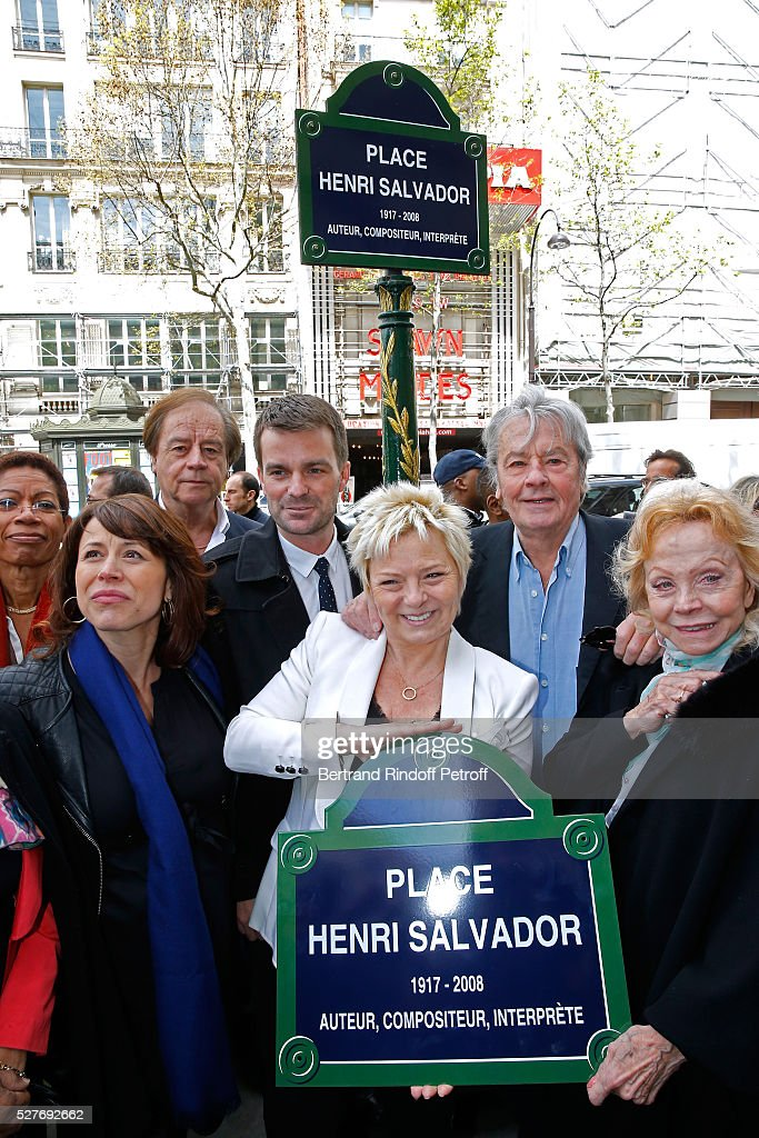 Journalist Daniel Lauclair, Mayor of 9th district of paris, Delphine Burkli, First Deputy Mayor of Paris, responsible for culture <a gi-track='captionPersonalityLinkClicked' href=/galleries/search?phrase=Bruno+Julliard&family=editorial&specificpeople=658518 ng-click='$event.stopPropagation()'>Bruno Julliard</a>, wife of Henri, Catherine Salvador, actor <a gi-track='captionPersonalityLinkClicked' href=/galleries/search?phrase=Alain+Delon&family=editorial&specificpeople=228460 ng-click='$event.stopPropagation()'>Alain Delon</a> and singer Isabelle Aubret attend the Henri Salvador's Square unveiling on May 03, 2016 in Paris, .