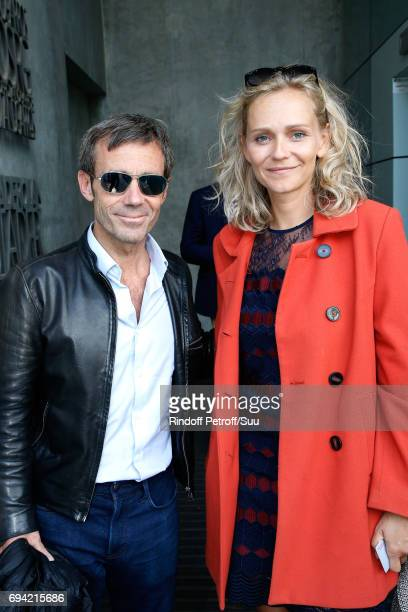 Journalist David Pujadas and actress Claire Borotra attend the 2017 French Tennis Open Day Thirteen at Roland Garros on June 9 2017 in Paris France