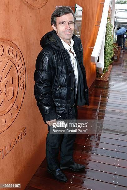Journalist David Pujadas attends the Roland Garros French Tennis Open 2014 Day 11 on June 4 2014 in Paris France