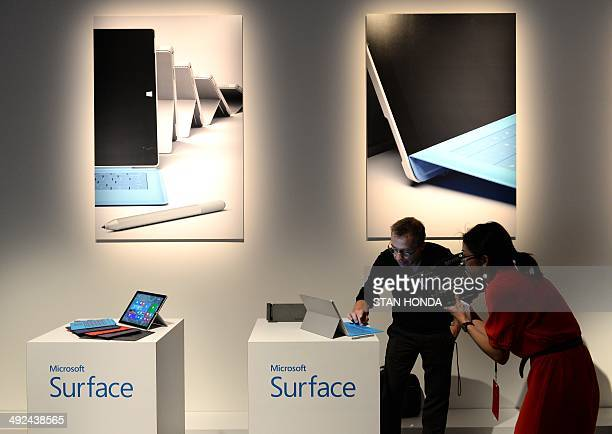 Journalist demo the new Microsoft Surface Pro 3 tablet after it was unveiled May 19 2014 in New York Microsoft unveiled the Surface Pro 3 tablet at...