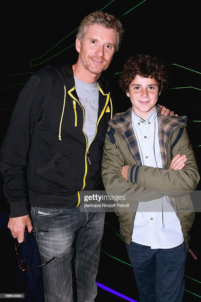 TV Journalist Denis Brogniart and his son attend the day six of the BNP Paribas Tennis Masters, held at Bercy on November 2, 2013 in Paris, France.