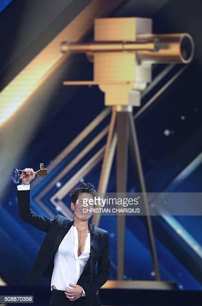 TV Journalist Dunja Hayali receives the Golden Camera award in Hamburg northern Germany on February 6 2016 / AFP / POOL / Christian Charisius