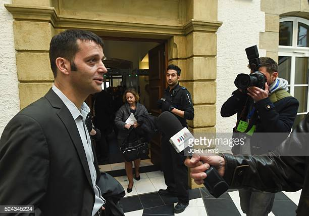 Journalist Edouard Perrin answers journalists' questions as he arrives at the courthouse in Luxembourg on April 26 for a trial over the socalled...