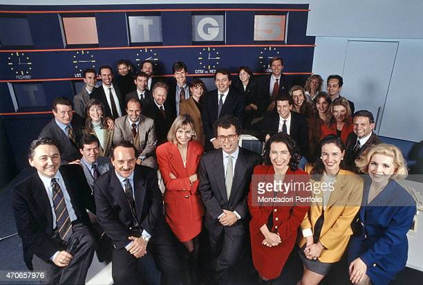 'Journalist Enrico Mentana smiling with the whole crew of the Tg5 the brand new newscast of Canale 5 with Director Mentana his Deputy Directors at...