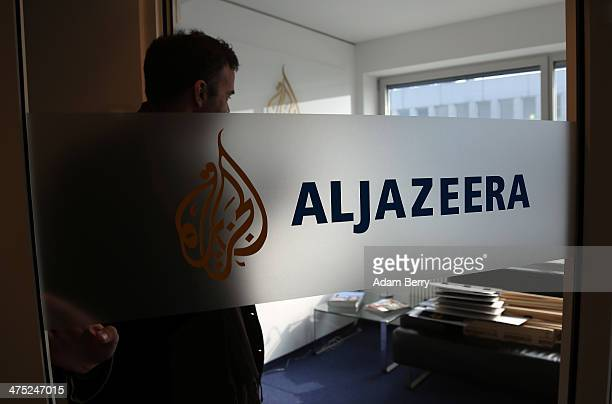 A journalist enters the Al Jazeera bureau in Berlin after a demonstration for the news organization's reporters currently in jail in Cairo as well...