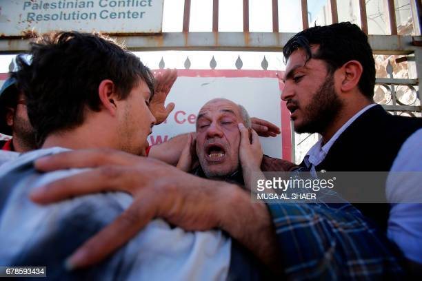 TOPSHOT AP journalist Eyad Hamad suffers from exposure to tear gas during clashes between Palestinian protesters and Israeli security forces...