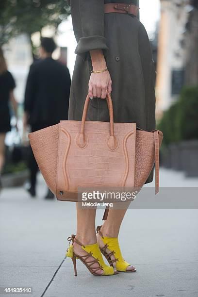 Journalist Fabologiecom founder Adi Heyman wears a Lanvin jacket Aquazurra shoes and Celine bag after Edun Day 4 of New York Fashion Week...