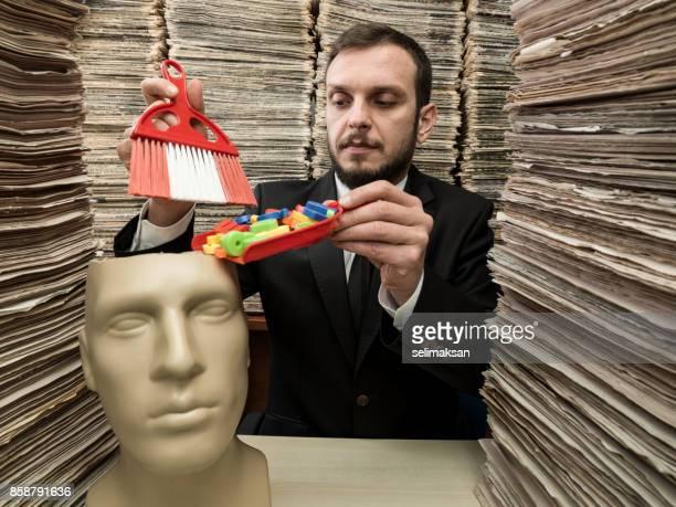Journalist Filling Knowledge Into Plastic Mannequin Brain
