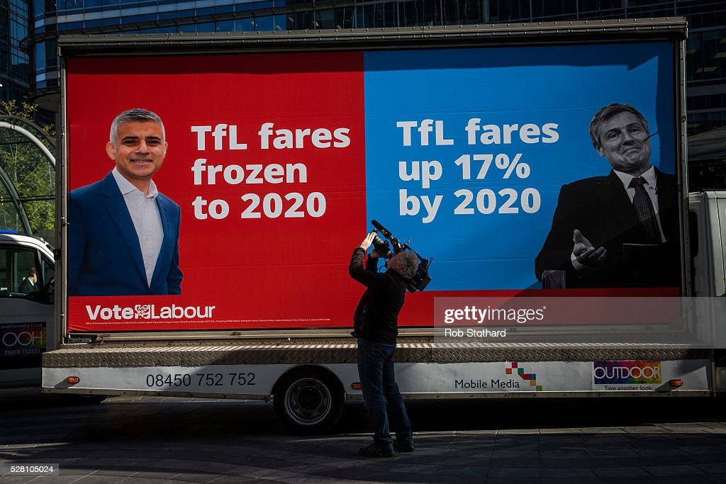 A journalist films campaign adverts for Labour's London Mayoral candidate Sadiq Khan and member of Parliament for Tooting in Montgomery Square in Canary Wharf on May 4, 2016 in London, England. Londoners will go to the polls tomorrow to vote for Mayor Of London with Labour's candidate expected to beat Conservative Party rival Zac Goldsmith to the position.