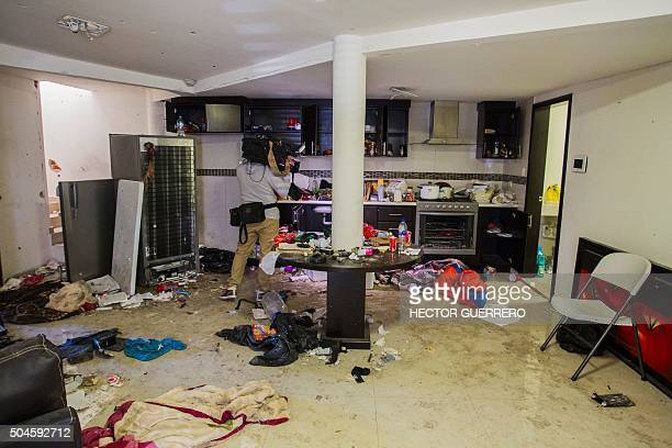 A journalist films on January 11 2016 inside the house where five gang member suspects were killed in the military operation which resulted in the...