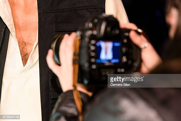 A journalist films the chest hair of a wax figure of the actor Harrison Ford as the Star Wars character Han Solo displayed on the occasion of Madame...
