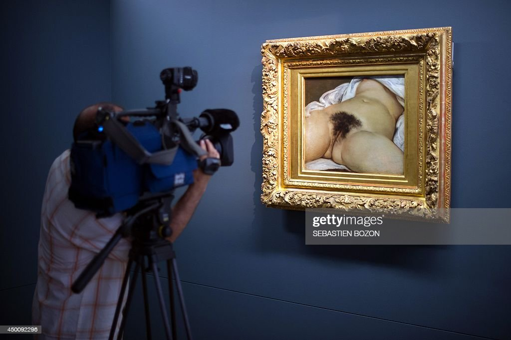 A journalist films the Gustave Courbet's canvas 'L'origine du monde' at the Courbet museum on June 3 in Ornans eastern France The canvas will be the...