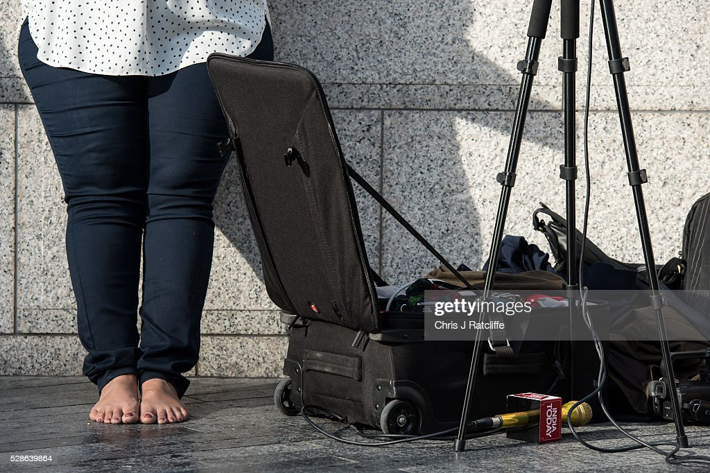 A journalist from India Today stands barefoot with a golden microphone on the ground whilst awaiting the results of the London Mayoral election race outside City Hall on May 06, 2016 in London, England. This is the fifth mayoral election since the position was created in 2000. Previous London Mayors are Ken Livingstone for Labour and more recently Boris Johnson for the Conservatives. The main candidates for 2016 are Sadiq Khan, Labour, Zac Goldsmith, Conservative, Suan Berry, Green, Caroline Pidgeon, Liberal Democrat, George Galloway, Respect, Peter Whittle, UKIP and Sophie Walker, Women's Equality Party.