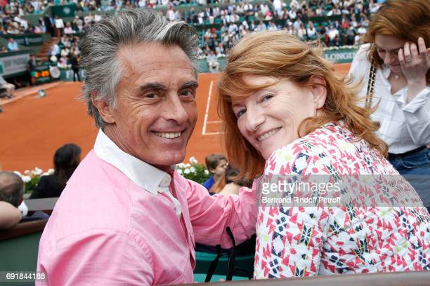 Journalist Gerard Holtz and his wife Director of the Villa Medicis in Roma Murielle Mayette attend the 2017 French Tennis Open Day Seven at Roland...