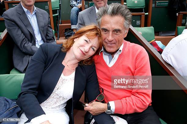 Journalist Gerard Holtz and his wife Muriel Mayette attend the 2015 Roland Garros French Tennis Open Day Three on May 26 2015 in Paris France