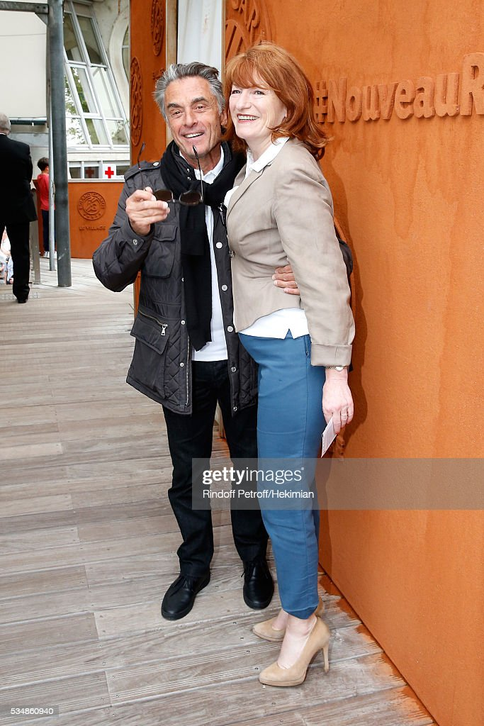 Journalist Gerard Holtz and his wife Murielle Mayette attend Day Seven of the 2016 French Tennis Open at Roland Garros on May 28, 2016 in Paris, France.