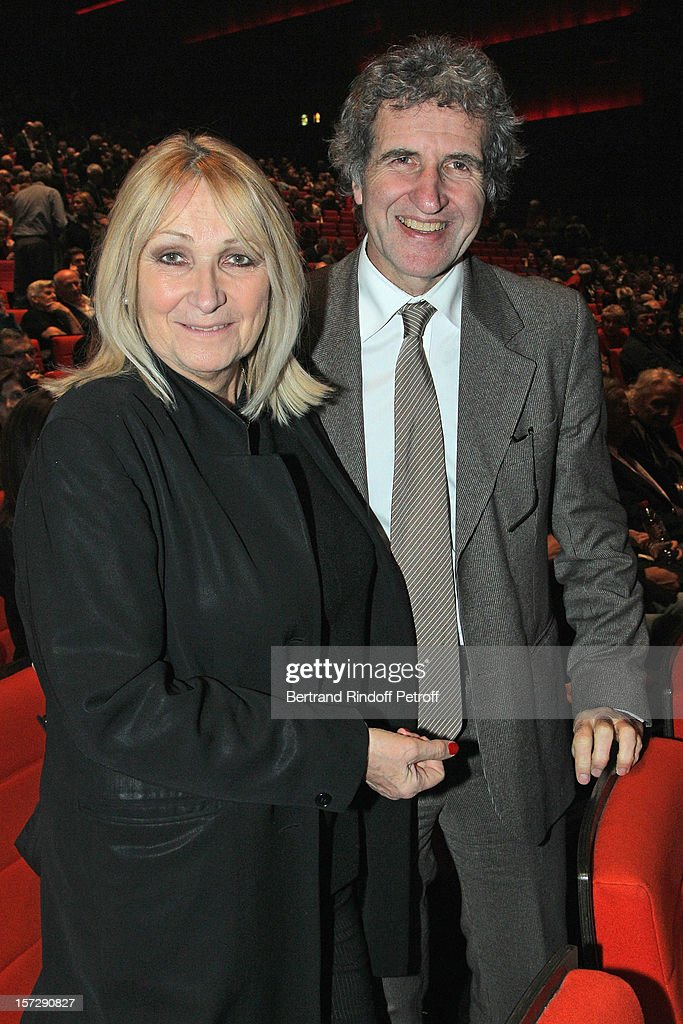 Journalist Gerard Leclerc (R) and his wife Julie pose in the auditorium prior to French impersonator Laurent Gerra's One Man Show at Palais des Congres on November 29, 2012 in Paris, France.