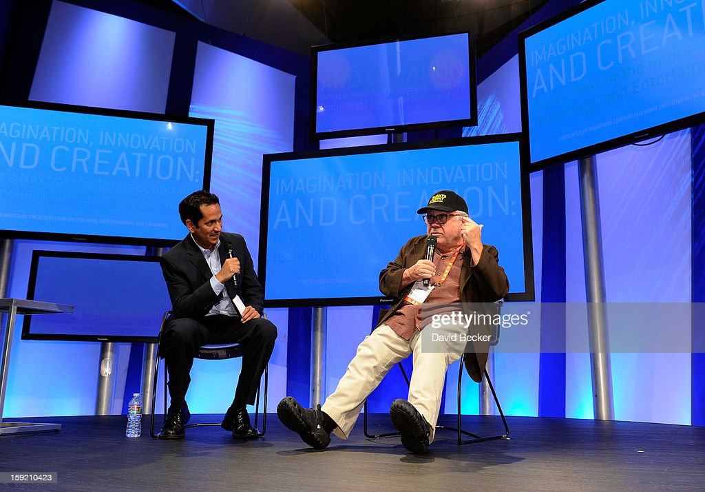 Journalist Greg Sandoval (L) and actor/director Danny DeVito appear on stage at the Panasonic booth during the 2013 International CES at the Las Vegas Convention Center on January 9, 2013 in Las Vegas, Nevada. CES, the world's largest annual consumer technology trade show, runs through January 11 and is expected to feature 3,100 exhibitors showing off their latest products and services to about 150,000 attendees.