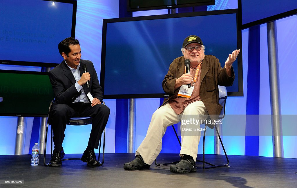 Journalist Greg Sandoval (L) and actor/director Danny DeVito speak on stage at the Panasonic booth during the 2013 International CES at the Las Vegas Convention Center on January 9, 2013 in Las Vegas, Nevada. CES, the world's largest annual consumer technology trade show, runs through January 11 and is expected to feature 3,100 exhibitors showing off their latest products and services to about 150,000 attendees.