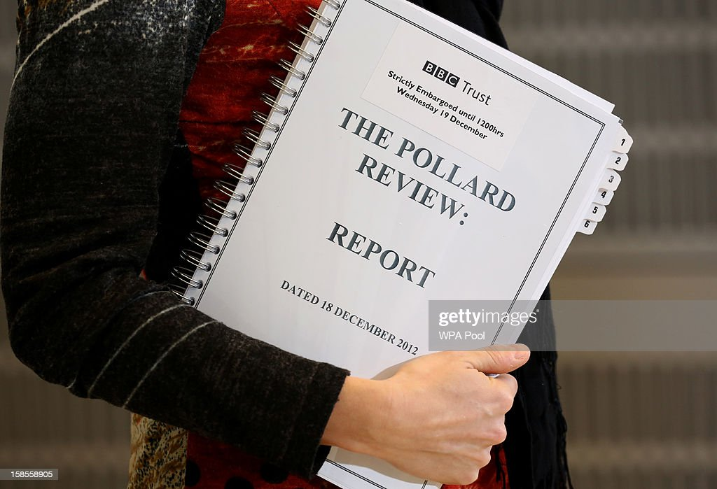A journalist holds a copy of The Pollard Report at New Broadcasting House, Portland Place, on December 19, 2012 in London, England. The BBC Trust has announced the findings of the Pollard Review into the corporation's handling of sexual abuse allegations against former employee Jimmy Savile. Among the findings were that former Director-General George Entwistle failed to heed warnings relayed to him via email of Savile's 'dark side'.