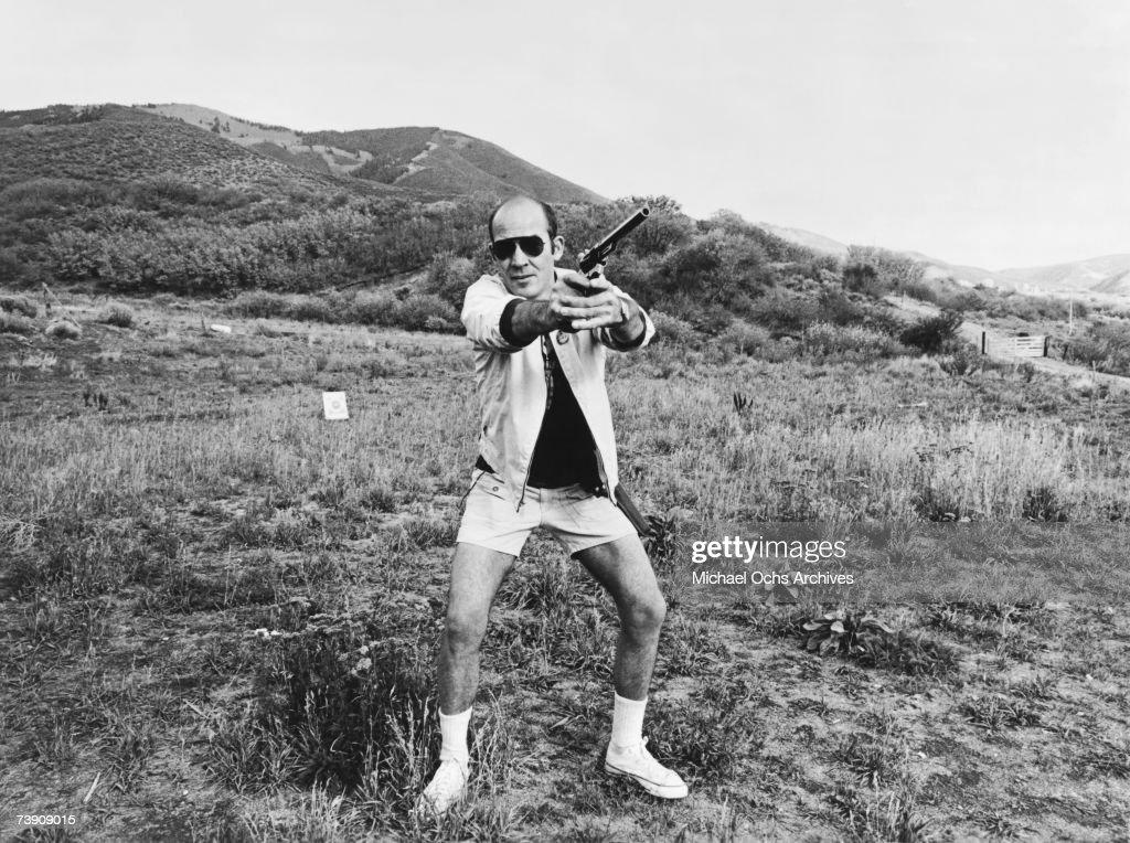 Journalist Hunter S. Thompson aims his Magnum on his ranch circa 1976 near Aspen Colorado.