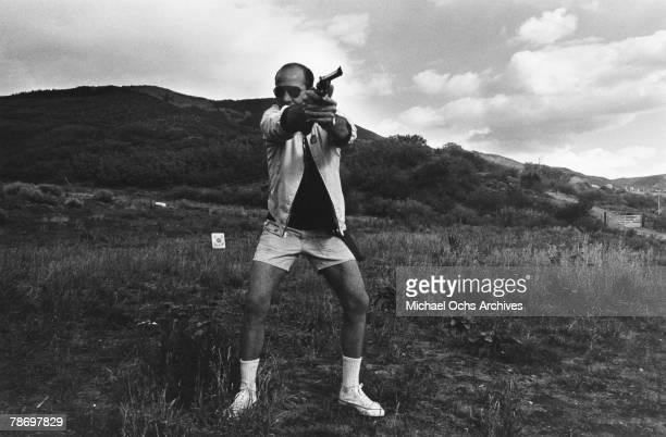 Journalist Hunter S Thompson aims his Magnum on his ranch circa 1976 near Aspen Colorado