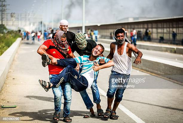 A journalist injured in the Israeli security forces intervention receives treatment during a protest against Israeli violations at the Erez border...