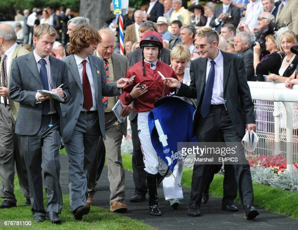 Journalist interview Jockey Jamie Spencer after his horse Sariska failed to leave to the starting stalls in the Darley Yorkshire Oaks
