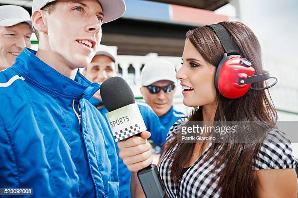 Journalist interviewing athlete