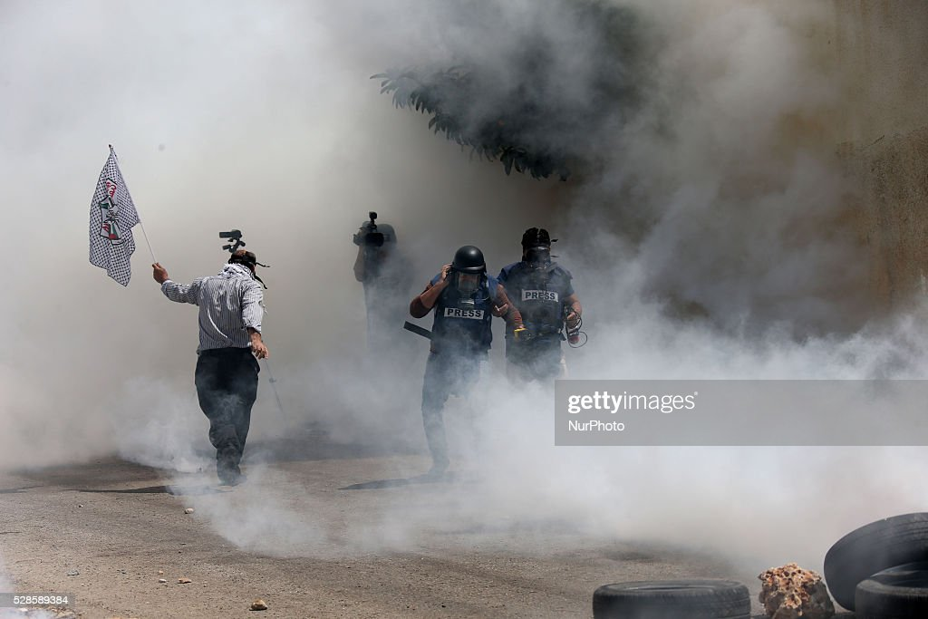 A Journalist is evacuated after he was wounded by tear gas fired by Israeli soldier during a protest against the expanding of Jewish settlements in Kufer Qaddom village, near the West Bank city of Nablus. May 6, 2016.