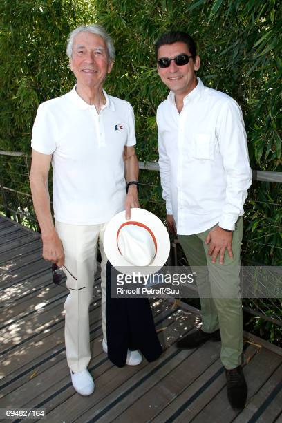 Journalist JeanClaude Narcy and his son attend the Men Final of the 2017 French Tennis Open Day Fithteen at Roland Garros on June 11 2017 in Paris...