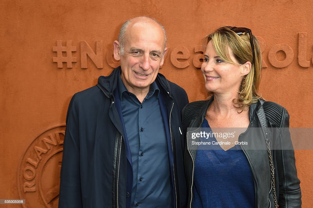 Journalist Jean-Michel Aphatie and his wife Stephanie attend day eight of the 2016 French Open at Roland Garros on May 29, 2016 in Paris, France.