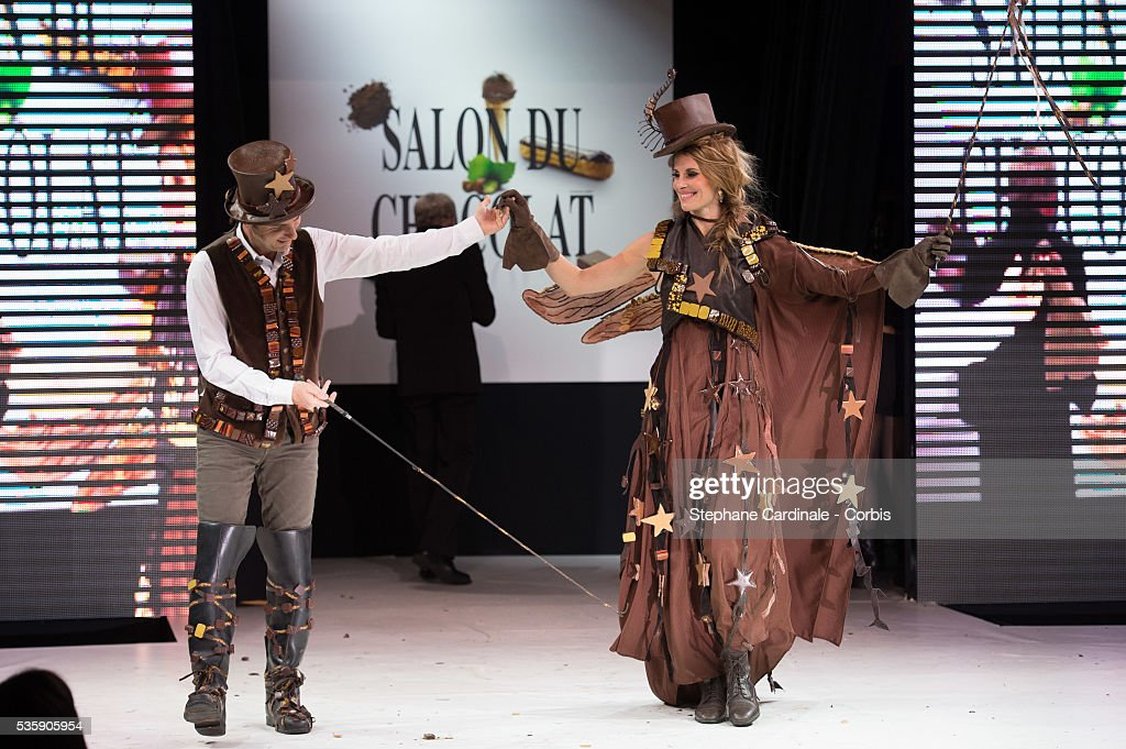 Journalist Jean-Philippe Doux and TV presenter and model Sophie Thalmann walk the runway during the Fashion Chocolate Show at Salon du Chocolat at Porte de Versailles, in Paris.