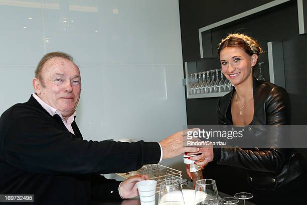 Journalist JeanRene Godar and Journalist and former tennis player Tatiana Golovin attend Roland Garros Tennis French Open 2013 Day 6 on May 31 2013...