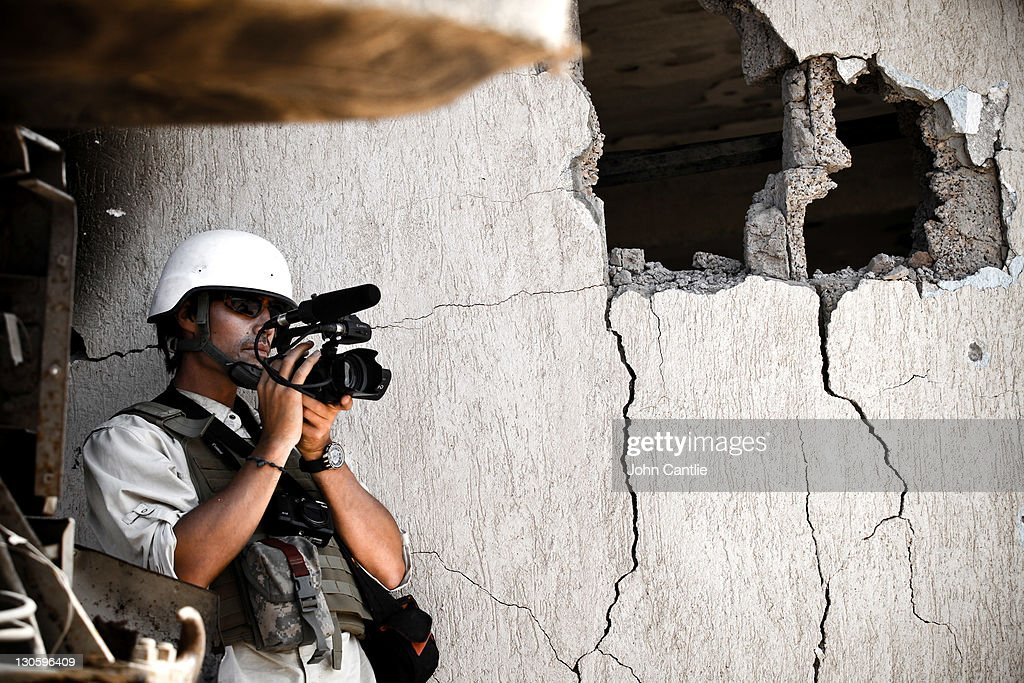 Journalist Jim Foley films Libyan NTC fighters attacking the west side of Colonel Gaddafi's home city of Sirte on October 05, 2011 in Libya. NTC forces are continuing their advance on Colonel Muammar Gaddafi's hometown of Sirte.