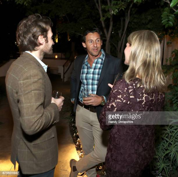Journalist Kaj Larsen and guests attend GLG social impact dinner at Sunset Marquis Hotel Villas on May 1 2017 in West Hollywood California