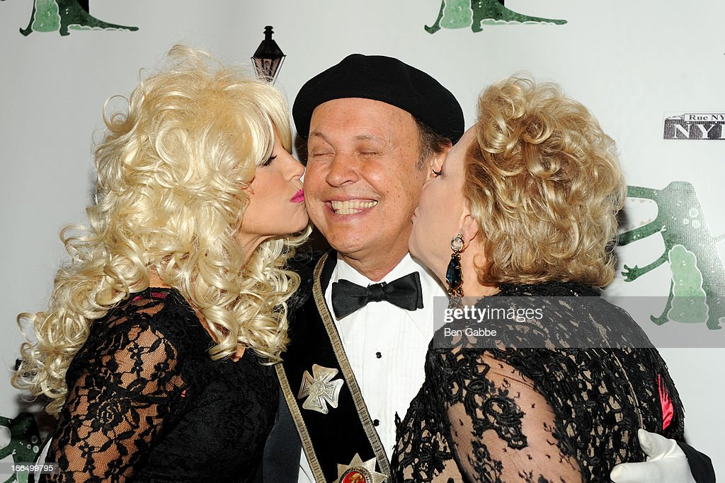 Journalist Katie Couric, actor Billy Crystal and actress Bette Midler attend the 18th Annual 'Hulaween In The Big Easy' Event at The Waldorf=Astoria on October 31, 2013 in New York City.