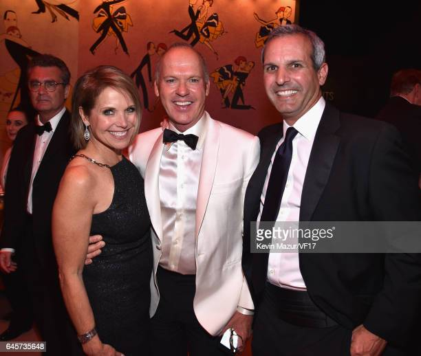 Journalist Katie Couric actor Michael Keaton and John Molner attends the 2017 Vanity Fair Oscar Party hosted by Graydon Carter at Wallis Annenberg...