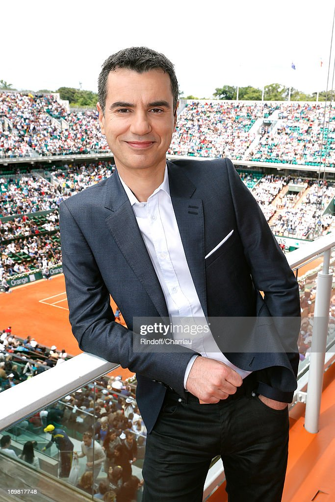 Journalist Laurent Luyat attends Roland Garros Tennis French Open 2013 - Day 8 on June 2, 2013 in Paris, France.